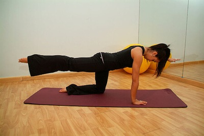 Female practicing a Pilates pose.
