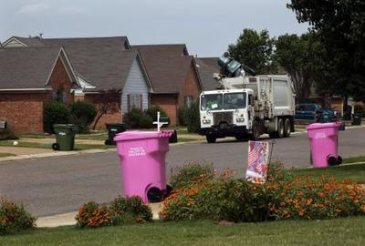 Southaven, Mississippi residents join the grassroots movement featuring pink garbage carts, enabling households nationwide to make a visible demonstration of their support for breast cancer awareness. (photo by Lance Murphey)