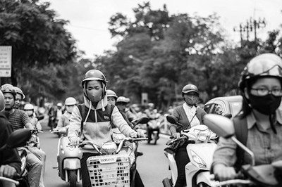 People wearing masks while riding mopeds in Asia.