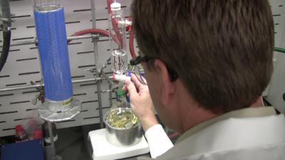 Chemist with test tube