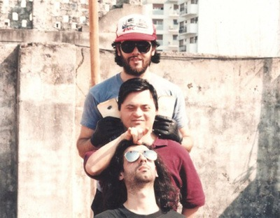 The cult band Reynols trio consisting of Roberto Conlazo, Alan Courtis, and Miguel Tomasin - a drummer with Down's Syndrome.