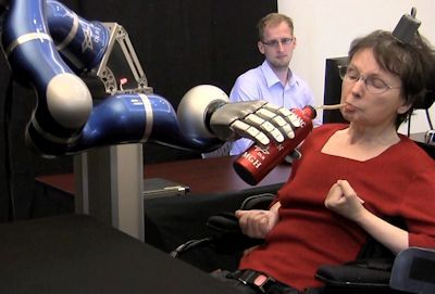 Using a robot arm, Cathy was able to lift a bottle and drink for the first time in 15 years