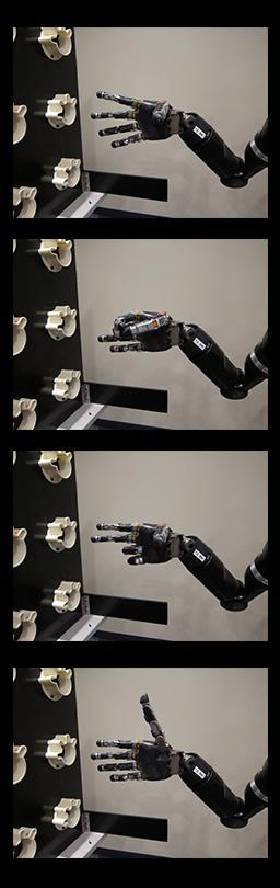 Controlling the robot arm with her thoughts, the participant shaped the hand into four positions: fingers spread, scoop, pinch and thumb up. Photo credit: Journal of Neural Engineering/IOP Publishing