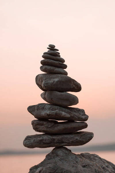 Closeup photography of balancing cairn stones.