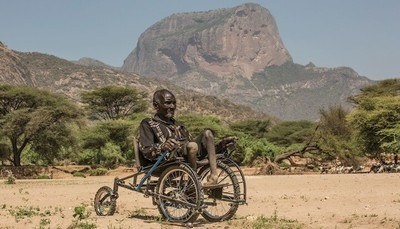 Man demonstrates ability of the allterrain SafariSeat Wheelchair