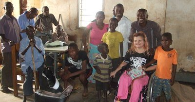 Sarah meeting members of the self-reliant group in Mbale who banded together because of their disabilities.