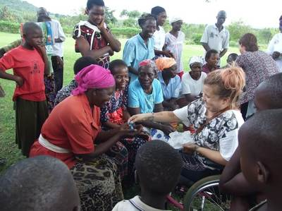 Sarah meeting women in Mbale whose crafts are helping to create their income.