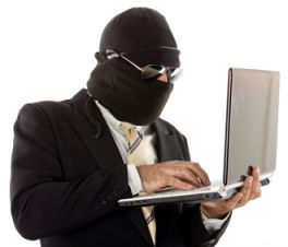 Hooded man holding laptop computer