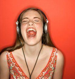 Girl singing with headphones on