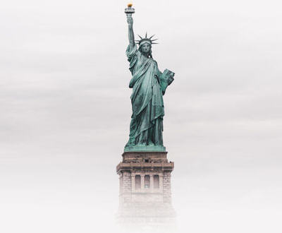 Statue of Liberty, New York, America on a foggy morning - Photo by Luke Stackpoole on Unsplash