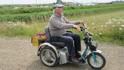 Disabled Rambler on mobility scooter in the countryside