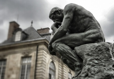 The Thinker is a bronze sculpture by Auguste Rodin. The work shows a male figure sitting on a rock with his chin resting on one hand as though deep in thought - often used as an image to represent philosophy.