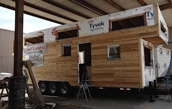 Kansas State University's Brandon Irwin, assistant professor of kinesiology, and Julia Day, assistant professor of interior design, are collaborating to build a tiny house, which led to research on the health benefits and challenges of starting tiny house villages across the US - Image Credit: Kansas State University