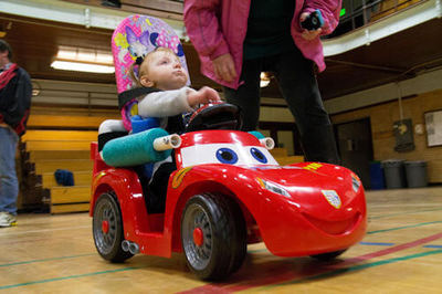 In this image, a toddler uses a Go Baby Go modified toy car - Photo Credit: Oregon State University