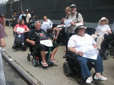 United Spinal Members protesting Ubers lack of wheelchair accessible cars - Picture Credit: United Spinal Association