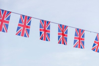 Several United Kingdom flags (Union Jack) strung in an overhead row.