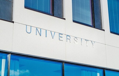 The word UNIVERSITY is written on building.