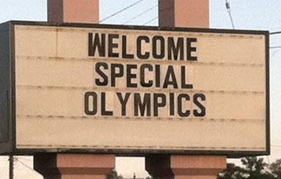 Sign out front of the hotel reading, Welcome Special Olympics