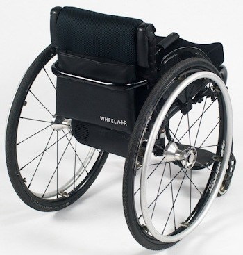 The wheelAIR cooling cushion shown mounted to the back of a manual wheelchair.