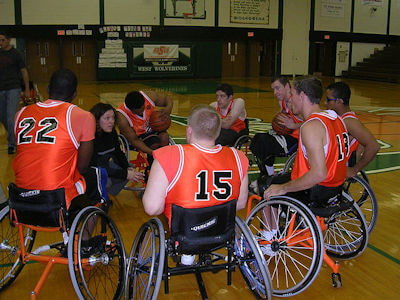Photo of wheelchair basketball players.
