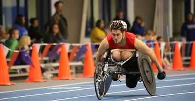 Man participating in a wheelchair race
