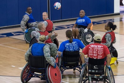 Edwards Air Force Base Airmen play a game of wheelchair rugby with Triumph Foundation members. The event was in recognition of National Disability Employment Awareness Month - (U.S. Air Force photo by Kyle Larson).