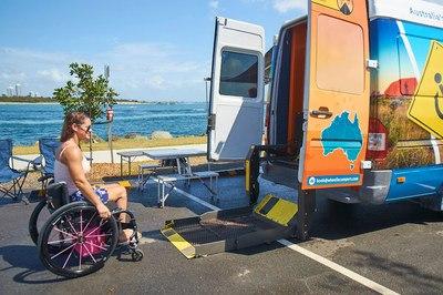 The rear of a Wheelie Camper showing a wheelchair access lift/hoist.